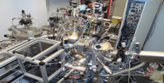 Pulsed Laser Deposion Facility with cluster-like structure, including distribution and storage chambers, and metallization chamber with several sputtering sources.